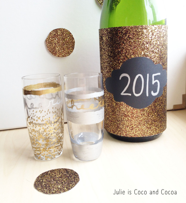 new years eve gold and silver glasses and wine bottle