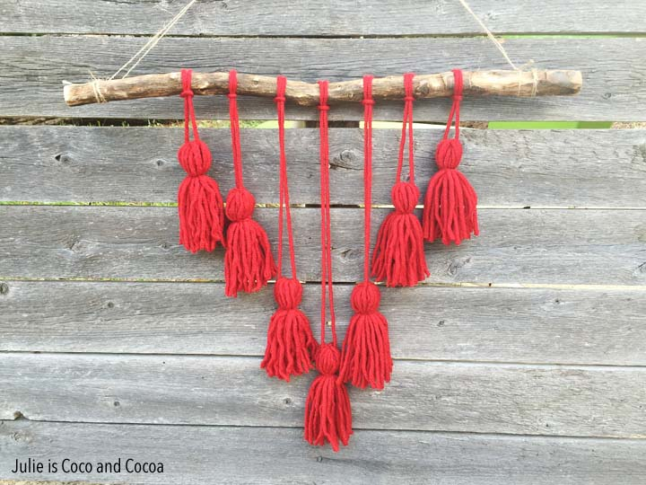 Easy Yarn Crafts from Julie is Coco and Cocoa. Yarn Pom Pom Flowers and Tassel Wall Hanging