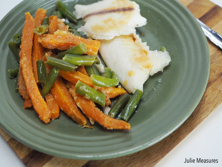 Oven baked fish and veggies foil packet dinner julie for Fish in foil in oven